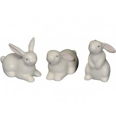 An assortment of 3 adorable bunny ornaments in different poses. A lovely interior decoration and seasonal gift item.