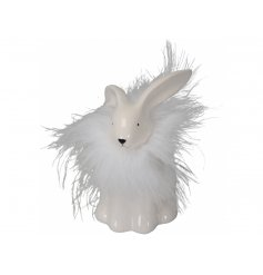 A fabulous white bunny decoration with a feather collar. A unique seasonal gift and chic decorative accessory.