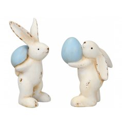 A mix of 2 shabby chic style bunny ornaments, each with a blue egg. A charming seasonal gift.