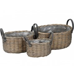 A set of 3 woven wicker baskets with chunky handles. Complete with a plastic lining.