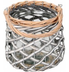 A coastal inspired candle holder with a woven willow detail and natural washed effect