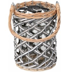 A stylish woven lantern with grey and white details. Complete with a chunky wicker handle. A stylish lantern