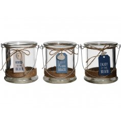 A charming assortment of glass candle holders, each decorated with a white or blue tag and scripted beach quote