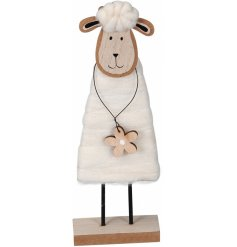 A charming wooden sheep decoration with a lovely decorative flower. A pretty seasonal accessory.