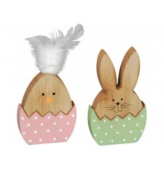 A sweet assortment of two wooden bunny decorated set inside polka dot patterned eggs