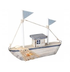 A charming wooden boat decoration, suitable for any Coastal Charm inspired home display