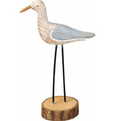 A rustic wooden seagull decoration, perfect for adding a Coastal Charm feel to your home