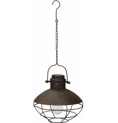 Bring a distressed charm to your garden decor with this stylishly rustic hanging metal solar light