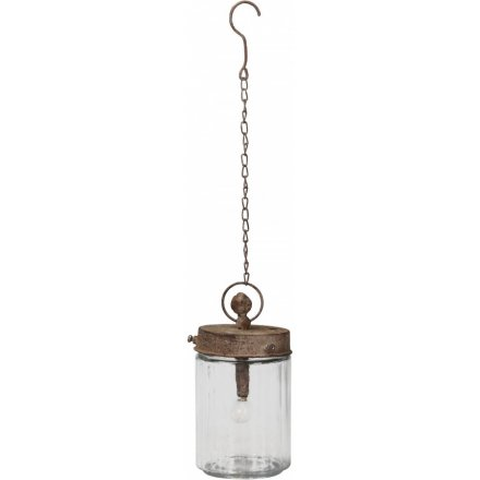 A rustic, vintage style LED Mason Jar lantern with a chain and hook to hang.