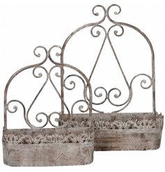 A set of 2 rustic style planters with a decorative pattern. Perfect for planting and for trailing plants.