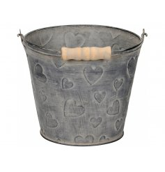 A shabby chic style metal bucket with wooden handle. Ideal for planting, storage and decoration.