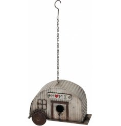 A rustic corrugated metal caravan birdhouse with a charming HOME sign