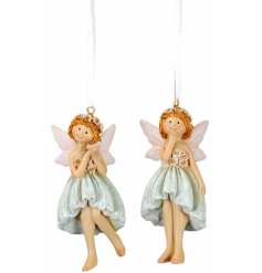 A mix of 2 pretty fairy decorations, each with a floral crown and dress.