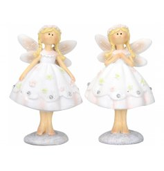 A mix of 2 pretty standing fairy ornaments, each with decorative floral skirts.