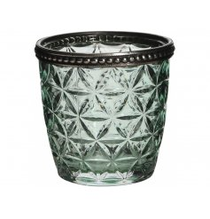 A vintage t-light holder with floral patterned glass and a grey metal decorative rim.