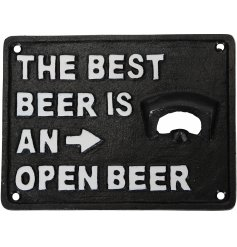 A rustic cast iron bottle opener reading 'the best beer is an open beer'