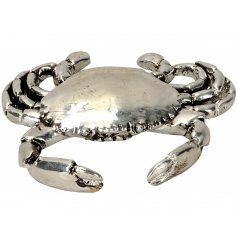 A chic decorative crab ornament with an aged finish.