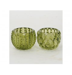 A mix of 2 vintage glass t-light holders each with a decorative pattern. Bringing a fresh look to the home.