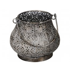 A beautifully coloured metallic lantern with a moroccan design and handle. A beautifully shaped candle holder.