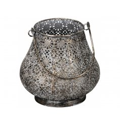 A stylish metallic lantern with a rustic moroccan design. Complete with handle.