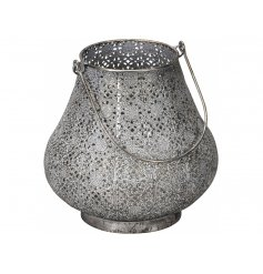 A beautifully shaped moroccan style lantern with an aged and distressed finish. A chic decorative accessory.