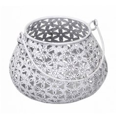 A pretty white metal lantern with a daisy design. This candle holder has a distressed finish and handle.