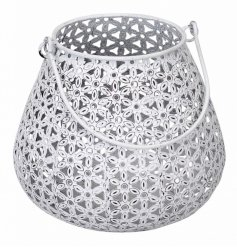 A shabby chic style metal lantern with a floral design. A chic accessory for the home and garden.