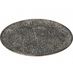 A stylish decorative plate with a distinct handmade look. An on trend rough luxe item for the home.