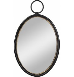 A vintage style oval mirror in black and gold. A statement decoration for the home.