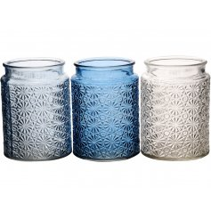 A mix of 3 blue coloured t-light holders with a decorative star and flower pattern.