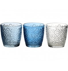 An assortment of 3 pretty glass t-light holders, each with a floral pattern. The assortment includes blue and clear