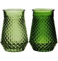 An assortment of 2 green glass vases with antique cut glass design. A chic decorative accessory.