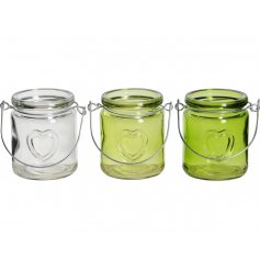 An assortment of 3 green and clear glass lanterns with an embossed heart detail. Complete with wire handle to hang.