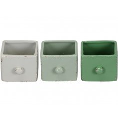 An assortment of 3 drawer shaped ceramic planters with a shabby chic finish.