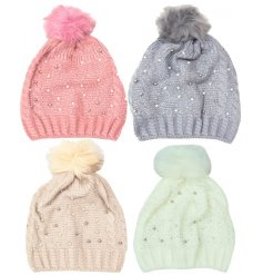 A mix of 4 cosy and stylish knitted hats with pearl and stone detailing and a pom pom.