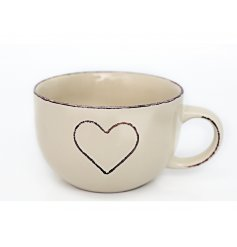 A gorgeous shabby chic mug in cream with an embossed heart.
