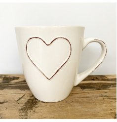 Enjoy your morning coffee in this gorgeous shabby chic mug with an embossed heart.
