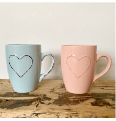 A charming assortment of pastel pink and blue toned mugs with an added embossed heart feature