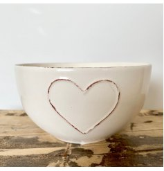 A gorgeous shabby chic bowl in cream with a rustic embossed heart. A must have tableware item.