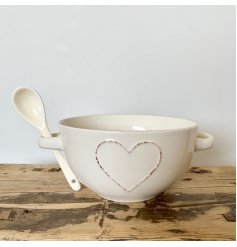 A stylish shabby chic bowl with a heart design and twin handles.