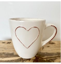 A gorgeous shabby chic style mug in cream with a distressed heart motif and handle.