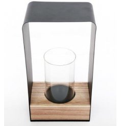 A chic and contemporary candle holder set within a natural wooden base. A stylish accessory for any home.
