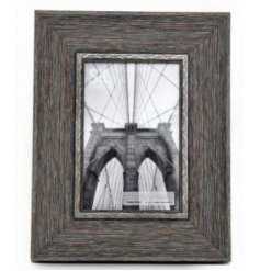 A stylish and contemporary wood effect photo frame in grey.