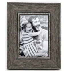 A stylish wood effect photo frame with a grey finish. A chunky and contemporary photo frame making a chic interior item