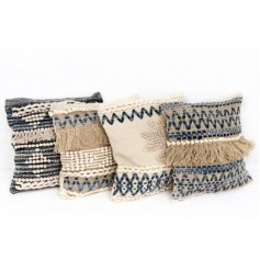 An assortment of 4 blue and white aztec cushions with tassel detailing.