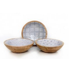 An assortment of 3 chunky wooden bowls, each with a beautiful decorative pattern in enamel. A chic accessory.