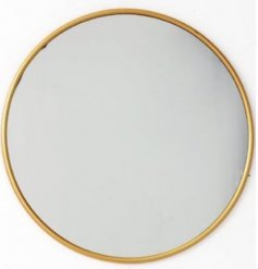 A chic round mirror with a gold frame. A stylish interior accessory for the home.