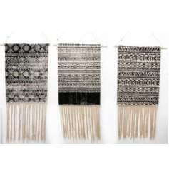 A stylish assortment of Aztec Print Hanging Wallart, each set with its own black white and mink decal