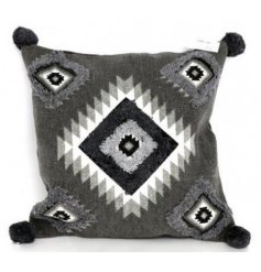 Stay on trend with this square aztec printed cushion with tufted pom poms.