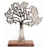 A chic decorative tree ornament with a silver tarnished finish. Set upon a chunky wooden base.